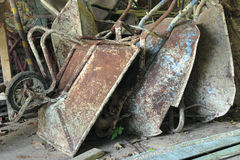 Old wheel barrows. For construction store at warehouse stock image