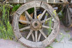 Old wheel is leaning against the old horse car royalty free stock photography