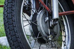 Old wheel motorcycle. Very old bicycle on an old motorbike Stock Images