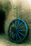 Old wheel and wall Royalty Free Stock Photo