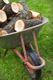An old wheelbarrow full of firewood Royalty Free Stock Images
