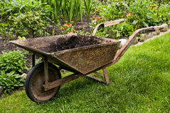 Old wheelbarrow in gadren Royalty Free Stock Photos