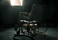 An old wheelchair in old room Royalty Free Stock Photo