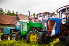 Old wheeled tractors. Wheeled tractors at countryside, ready to work Royalty Free Stock Photo