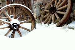 Old wheels. Near old house in winter Royalty Free Stock Images