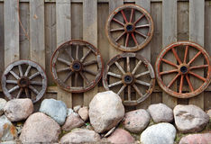 Old Wheels On A Wall Royalty Free Stock Image