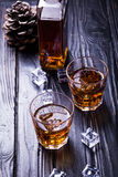 Old whisky and ice. Two glass with old whisky and ice on black background Royalty Free Stock Images