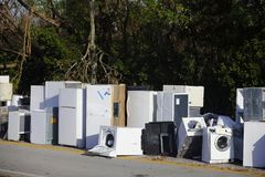 Old white appliances abandoned and left outside for recycling. Image of old appliances left outside for trash pickup after Hurricane Irma Stock Photos