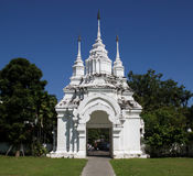 Old white asian temple entrance. With blue sky Stock Photo