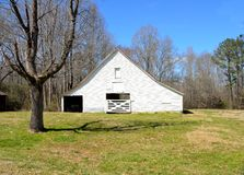 Old white barn shed in Georgia Royalty Free Stock Image