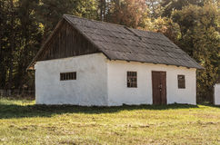 An old white barn with a wooden roof. Autumn time in the village in Ukraine Royalty Free Stock Images