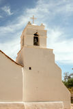 Old white bell tower. A white bell tower of a small south american church Stock Images