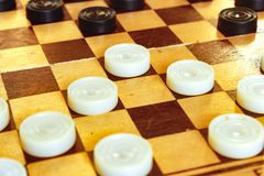 White and black checkers on the Board stock images