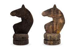 Old white and black chess knights. Isolated objects: two very old wooden chess pieces, knights, or horses, black and white Royalty Free Stock Image