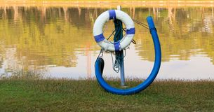 Old white and blue lifebuoy royalty free stock photography