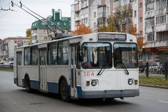 Old white with a blue stripe a trolleybus. Yoshkar-Ola. Russia - October 2018: Old white with a blue stripe a trolleybus in the center of a large city carries stock photo
