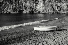 An Old White Boat On A Beach. An Old White Boat On The Beach Plage Mala In Cap d'Ail  In France Royalty Free Stock Photography