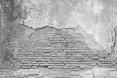 Old White brick wall with cracked concrete Royalty Free Stock Photography