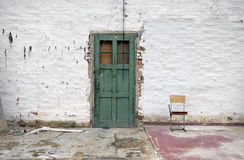 Old white brick wall with green door Royalty Free Stock Images