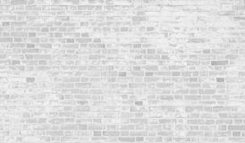Old white brick wall with peeling paint Royalty Free Stock Photo