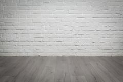 Old white brick wall and wood floor background. Old white brick wall and grey wood floor background Stock Image