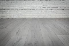 Old white brick wall and wood floor background. Old white brick wall and grey wood floor background Royalty Free Stock Images