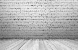 Old white brick wall and wooden floor. Textured background. Copyspace. Rough-surfaced Royalty Free Stock Photography