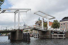 Old white bridge under the cloudy sky in the day in the center of Haarlem in the Netherlands Stock Images