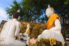 Old white Buddhist statue. Royalty Free Stock Photo