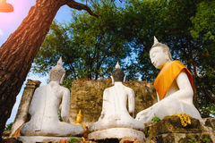 Old white Buddhist statue. Royalty Free Stock Images