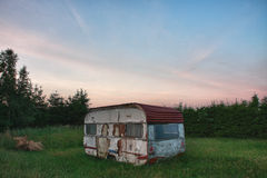 Old white camper in forest in summer morning Royalty Free Stock Photo
