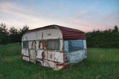 Old white camper in forest in summer morning Royalty Free Stock Photography