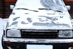 Old white car covered by snow in wintertime. Retro white car covered by snow in wintertime Stock Photography
