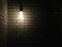 Old white ceramic wall texture with a dark light from bulb Stock Photography