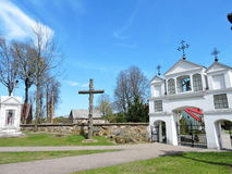 Old white church gate, Lithuania. Laukuva town church gate and graveyard , Lithuania Royalty Free Stock Image
