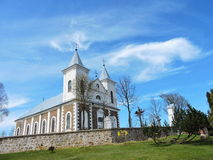 Old white church, Lithuania. Old catholic church in Laukuva town, Lithuania Royalty Free Stock Photos