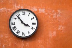 Old white clock on cement wall background with copy space. Old white clock  on cement wall background with copy space Stock Photo