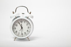 Old white clock on white background. Clock face Stock Photo