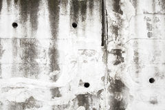 Old white concrete wall with holes, background texture Stock Photo