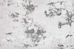 Old white concrete wall with paint cracks Stock Photos
