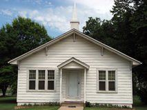 Old White Country Church. Plain, white country church in a grove of trees Royalty Free Stock Photos