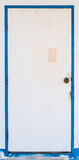 Old white door with blue jamb Stock Photography