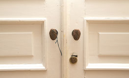 Old white door with brass handles Royalty Free Stock Photo