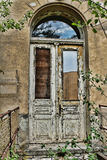 Old white door. In an old building Royalty Free Stock Image