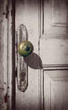 Old white door with golden doorknob. Closeup view Stock Photography