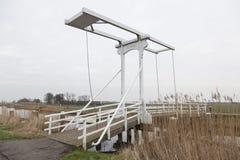 Old white drawbridge in the netherlands near Amsterdam Royalty Free Stock Photos