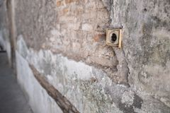 Cracked Concrete Vintage Wall with Electric Soket as the Foreground. royalty free stock image
