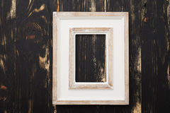 Old white empty frame on wooden background Royalty Free Stock Photography