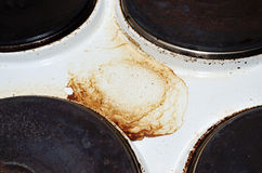 Old white enamelled dirty electric cooker Royalty Free Stock Photos