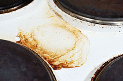 Old white enamelled dirty electric cooker Royalty Free Stock Images